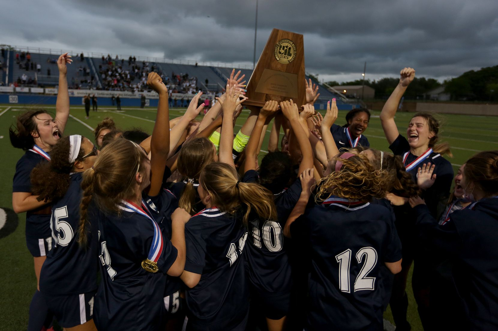 Lewisville Flower Mound players celebrate with the trophy after their UIL 6A girls State championship soccer game against Austin Vandegrift at Birkelbach Field on April 16, 2021 in Georgetown, Texas. Lewisville Flower Mound won 2-1. (Thao Nguyen/Special Contributor)