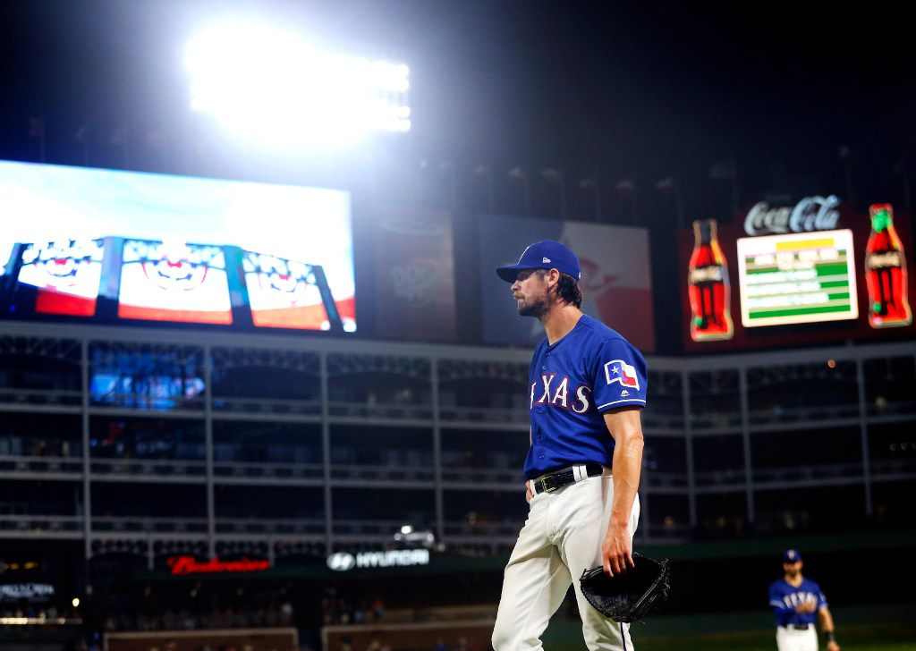 After the Texas Rangers turned a double pay to end the sixth inning, starting pitcher Cole Hamels (35) waits for the Miami Marlins dugout to challenge the call at Globe Life Park in Arlington, Tuesday, July 25, 2017. The Marlins did not challenge. (Tom Fox/The Dallas Morning News)