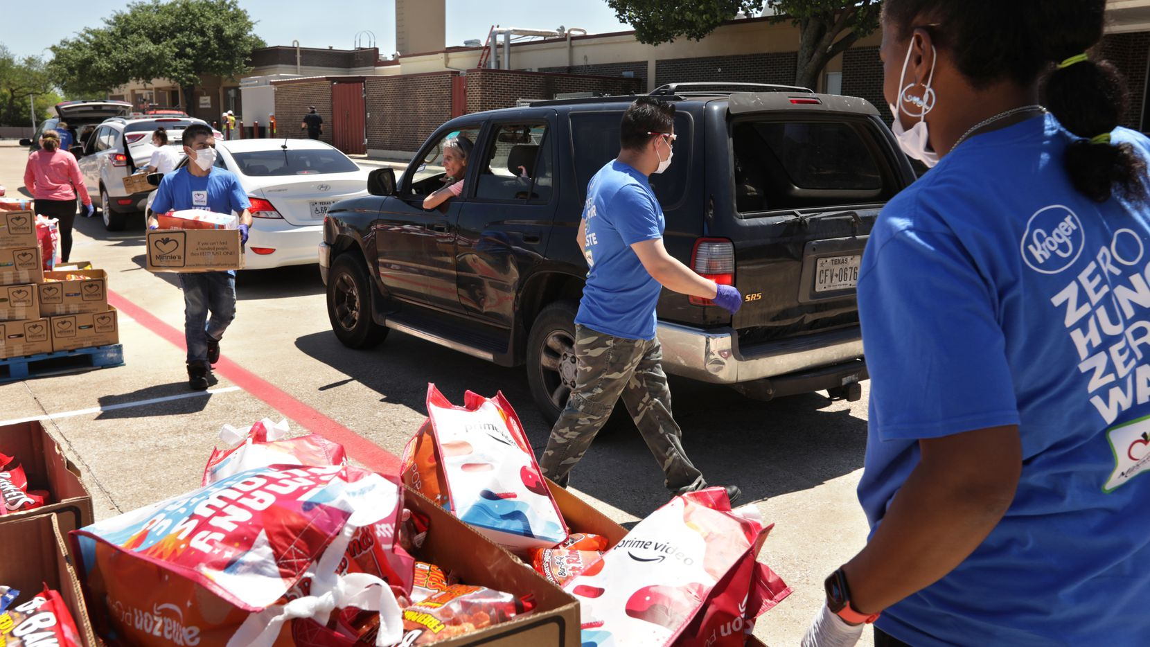 Minnie's Food Pantry has a partnership with Plano ISD to feed students whose households may be facing food insecurity. Here volunteers are serving more than 750 families at Bowman Middle School in Plano.
