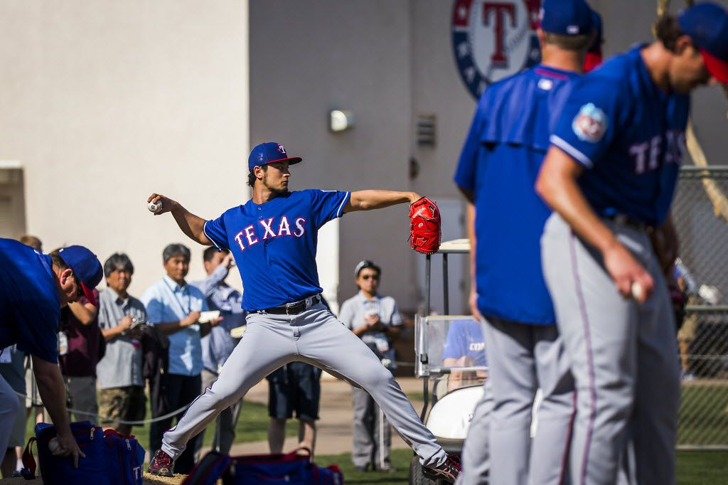 Texas Rangers pitcher Yu Darvish throws off a pitching mound in the bullpen during a spring workout at the team's training facility on Monday, Feb. 29, 2016, in Surprise, Ariz. (Smiley N. Pool/The Dallas Morning News)