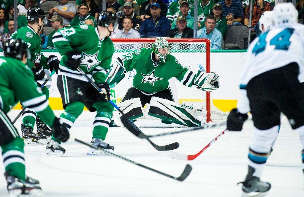 Dallas Stars goalie Kari Lehtonen (32) catches a puck shot by San Jose Sharks defenseman Marc-Edouard Vlasic (44) during the second period on Monday, March 20, 2017 at the American Airlines Center in Dallas, Texas. (Ashley Landis/The Dallas Morning News)