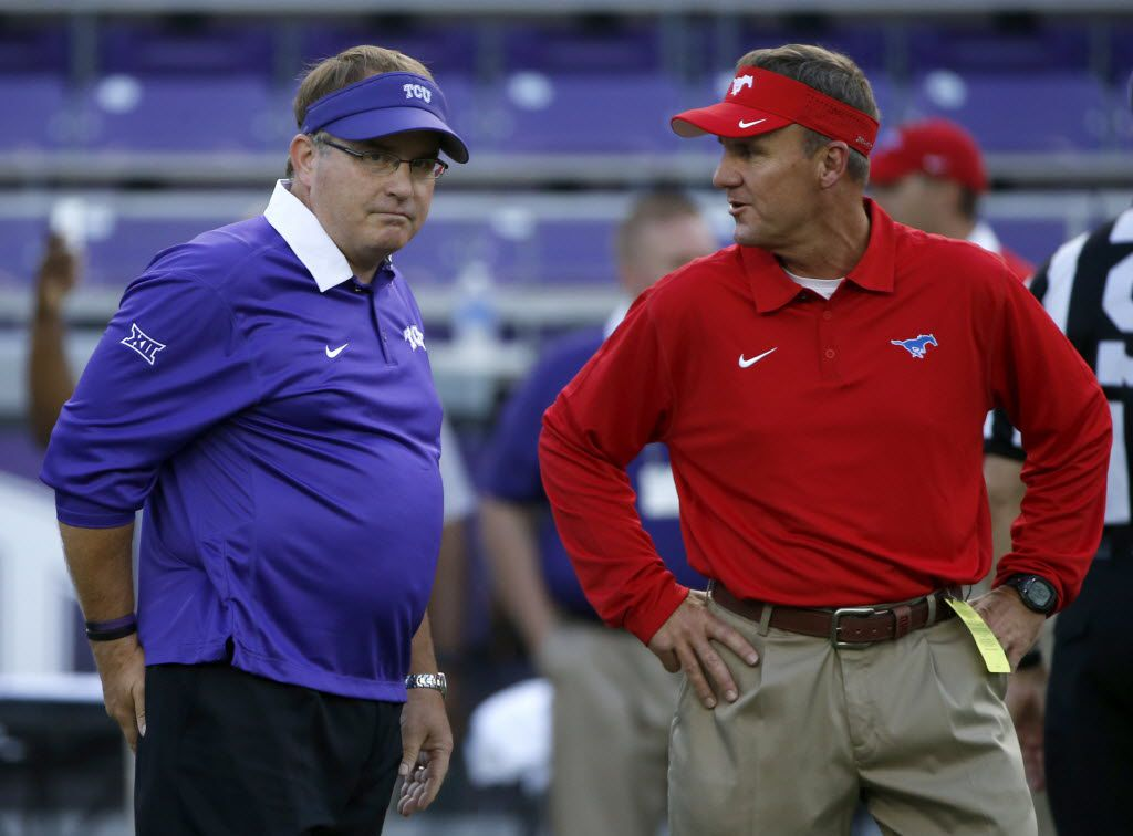 Head coach Gary Patterson of the TCU Horned Frogs and head coach Chad Morris of the Southern Methodist Mustangs talk before kick-off at Amon G. Carter Stadium on September 19, 2015 in Fort Worth, Texas. (Photo by Ron Jenkins/Getty Images)