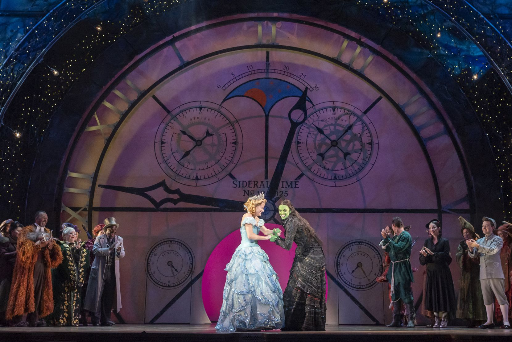 The characters Glinda (Allison Bailey), left, and Elphaba (Talia Suskauer) during the final moments of the curtain call during a dress rehearsal for 'Wicked,' hosted by Dallas Summer Musicals, at the Music Hall at Fair Park, on Aug. 1 in Dallas.