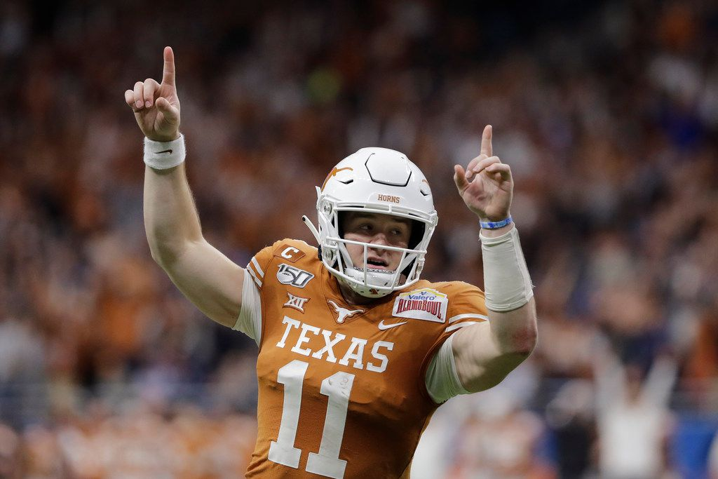 Texas quarterback Sam Ehlinger (11) celebrates a touchdown against Utah during the first half of the Alamo Bowl NCAA college football game in San Antonio, Tuesday, Dec. 31, 2019. (AP Photo/Austin Gay)