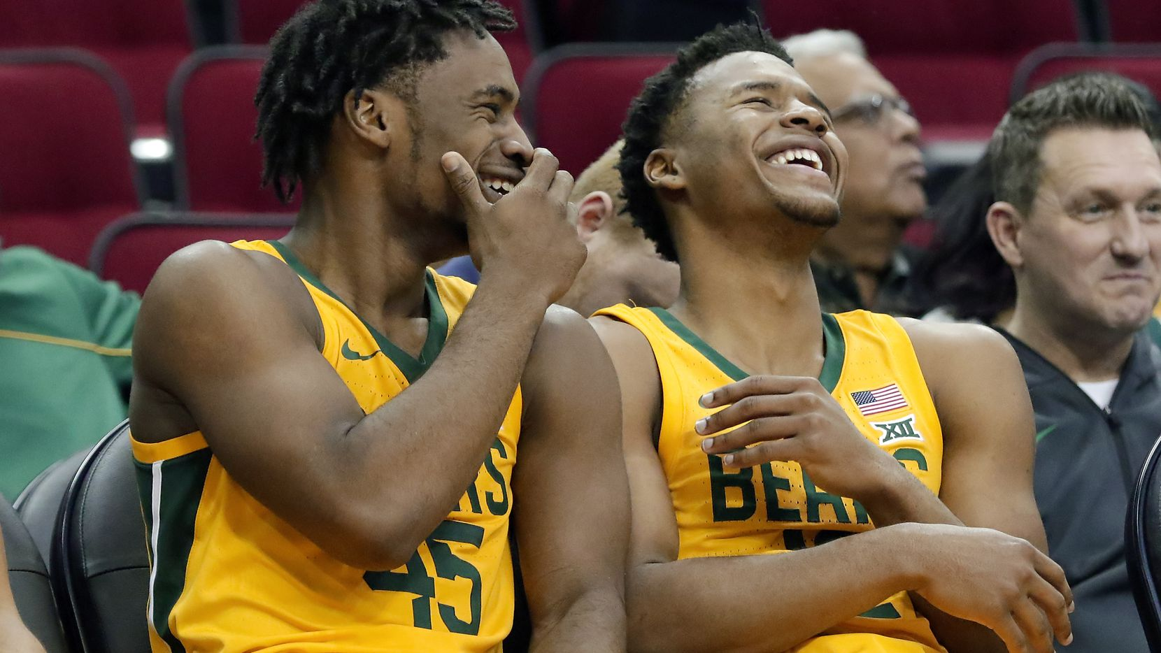 Baylor guard Davion Mitchell (45) and guard Jared Butler (12) laugh on the bench in the final minutes of the team's NCAA college basketball game against Tennessee-Martin Thursday, Dec. 19, 2019, in Houston.