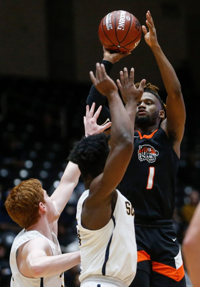 Lancaster's Mike Miles (1) puts up a shot during the first half of a boys basketball UIL Class 5A Region II semifinal between Lancaster and Highland Park on Friday, March 6, 2020 at Curtis Culwell Center in Garland, Texas. (Ryan Michalesko/The Dallas Morning News)