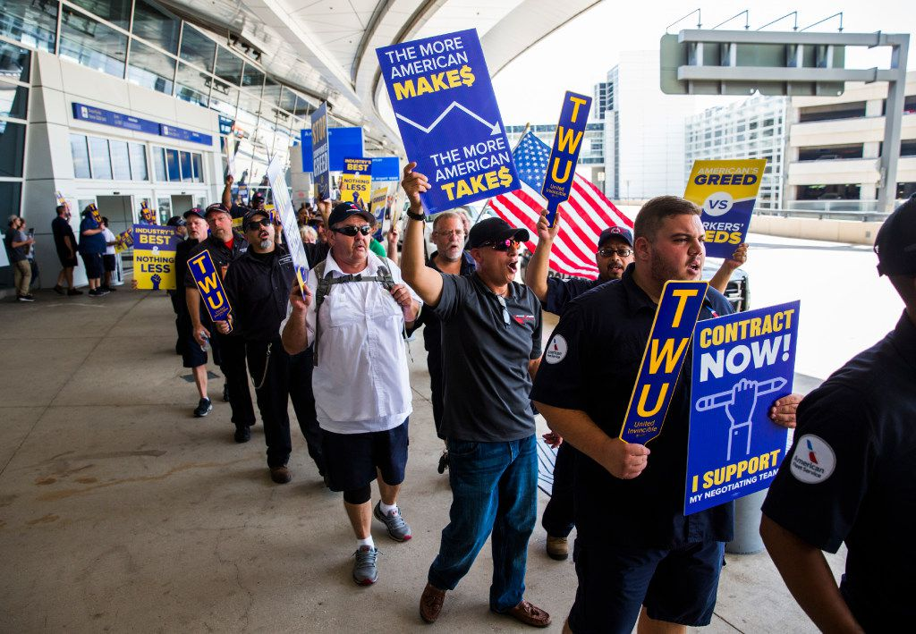 American Airlines employees protested the lack of a new contract for baggage carriers, mechanics and other staff in 2017 outside Terminal D at DFW International Airport.