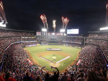Fans cheer at the start of the Texas Rangers-Baltimore Orioles American League Wildcard playoff  MLB baseball game at Rangers Ballpark in Arlington on October 5, 2012.