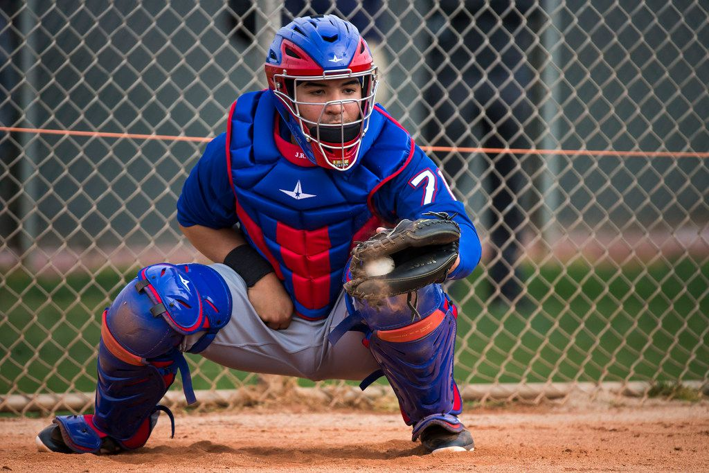 Texas Rangers catcher Jose Trevino catches in the bullpen during the first spring training workout for pitchers and catchers at the team's training facility on Thursday, Feb. 15, 2018, in Surprise, Ariz. (Smiley N. Pool/The Dallas Morning News)