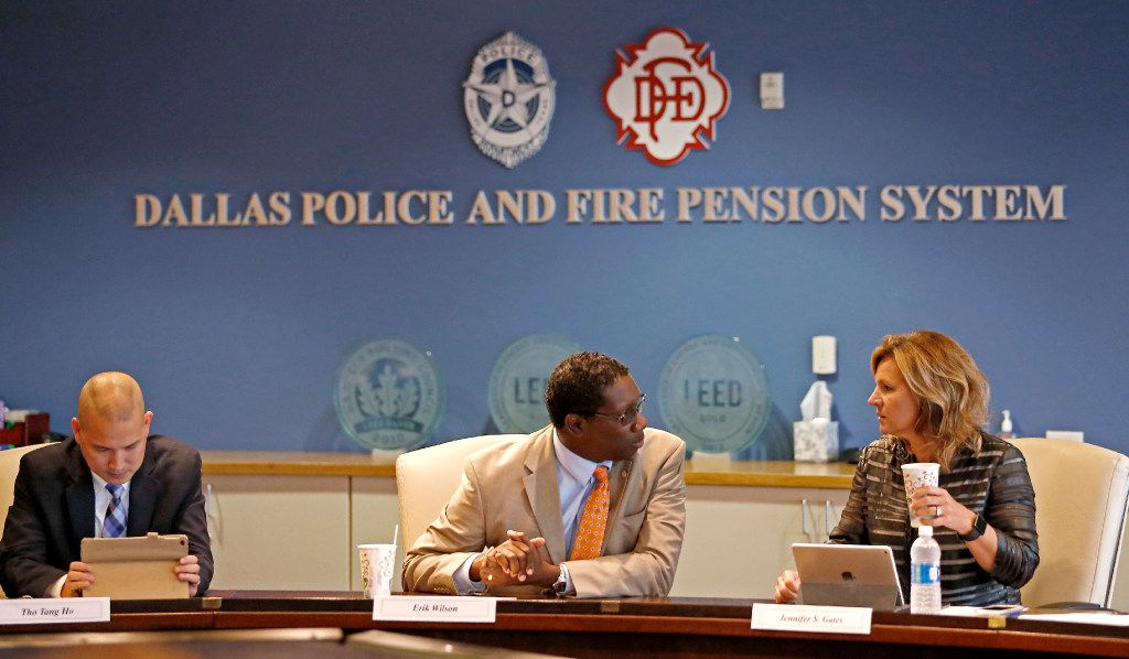 City Council member Erik Wilson (center) talked with City Council Jennifer Staubach Gates next to Tho Tang Ho of the Police Department during Thursday's board of trustees meeting of the Dallas Police and Fire Pension System. (Jae S. Lee/Staff Photographer)