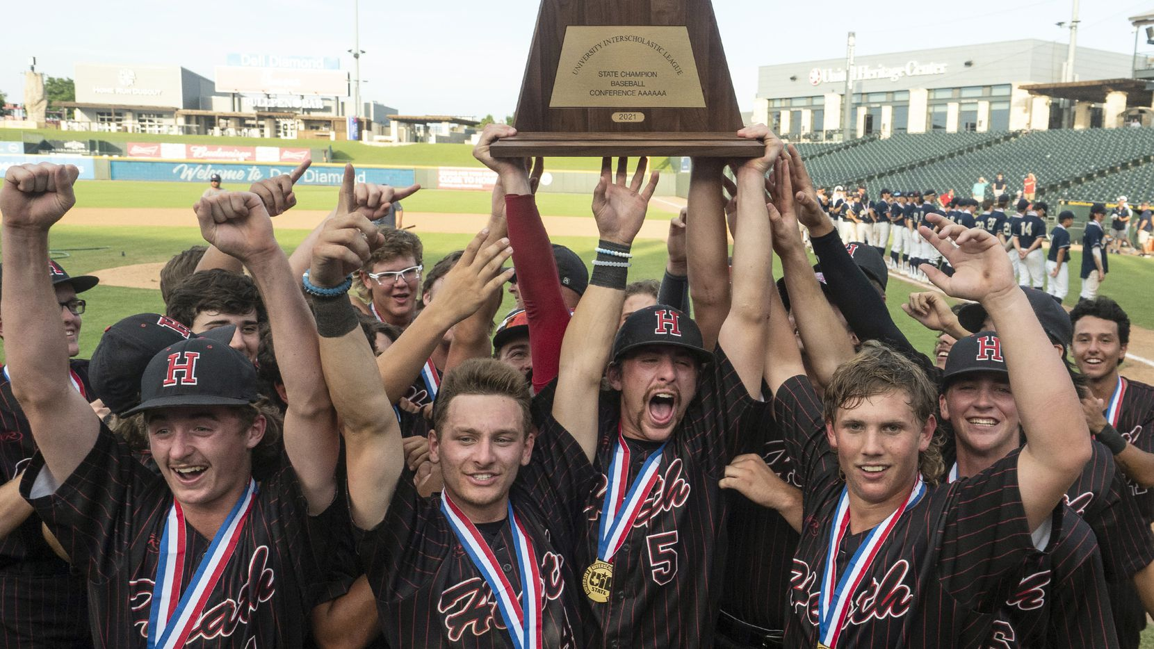 The Rockwall-Heath Hawks team celebrate with the championship trophy after defeating Keller in the 2021 UIL 6A state baseball final held, Saturday, June 12, 2021, in Round Rock, Texas.  Rockwall-Heath defeated Keller 4-3.