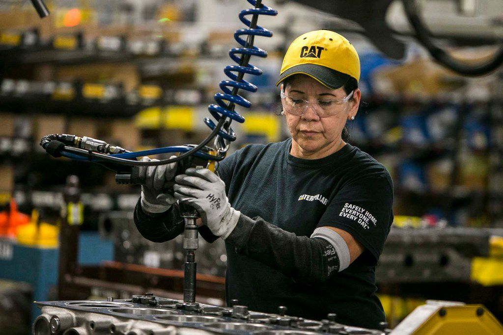 Margarita Cardenas attaches an engine head at Caterpillar's engine manufacturing plant in Seguin. Caterpillar is part of a broader heavy machinery and equipment manufacturing industry in Texas that employs about 90,000 people and shipped more than $40 billion in industrial machinery to international buyers last year, making it the state's second-leading export after petroleum and accounting for 16 percent of all Texas exports.