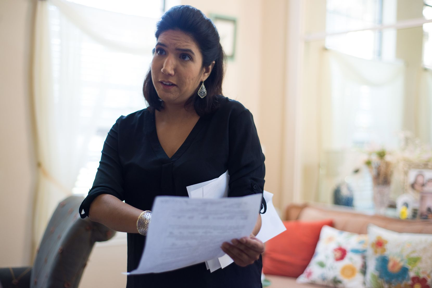 A rent-to-company threatened to file criminal charges against Austin resident Melinda Sandlin after she stopped making payments. Sandlin looks through her rental purchase agreement and other related documents at her Austin home.