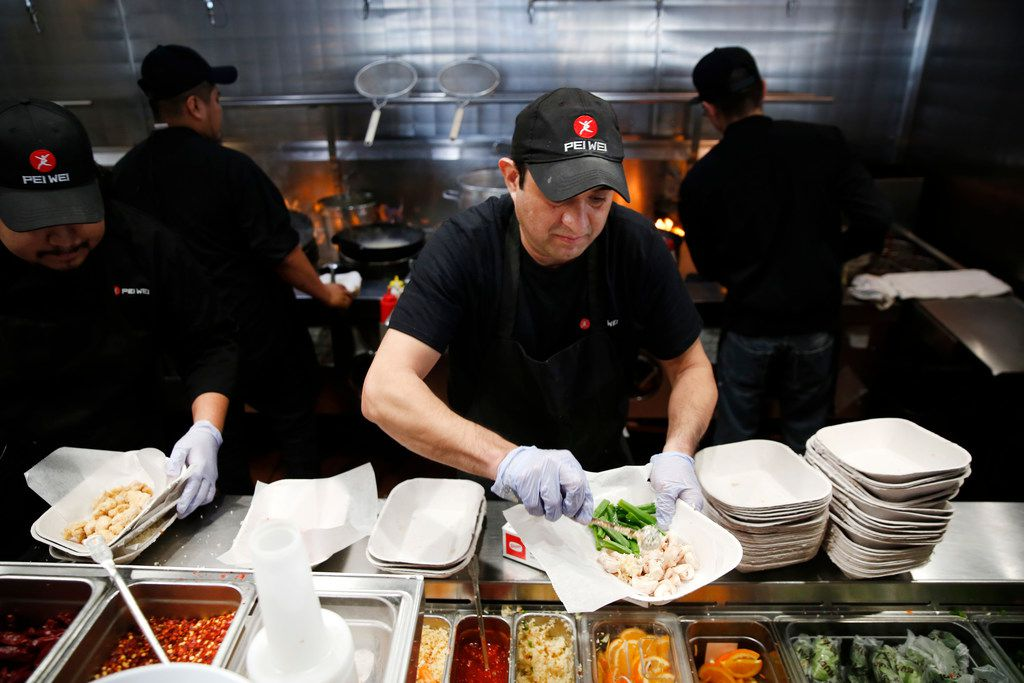 Gustavo Franco, wok cook, prepared a dish at Pei Wei in Irving on Feb. 7.