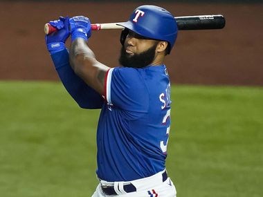 Texas Rangers outfielder Danny Santana bats during the first inning of an exhibition game at Globe Life Field on Wednesday, July 22, 2020.