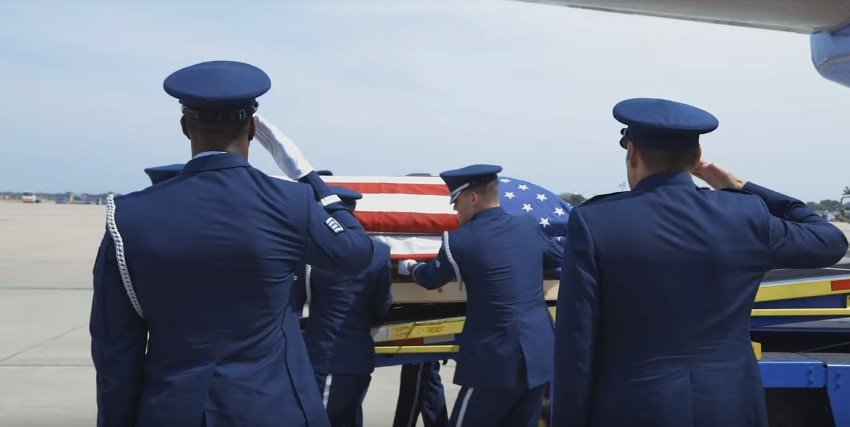 Air Force personnel transport the remains of Col. Roy Knight, Jr., who was shot down over northern Laos in 1967 as part of the Vietnam War.