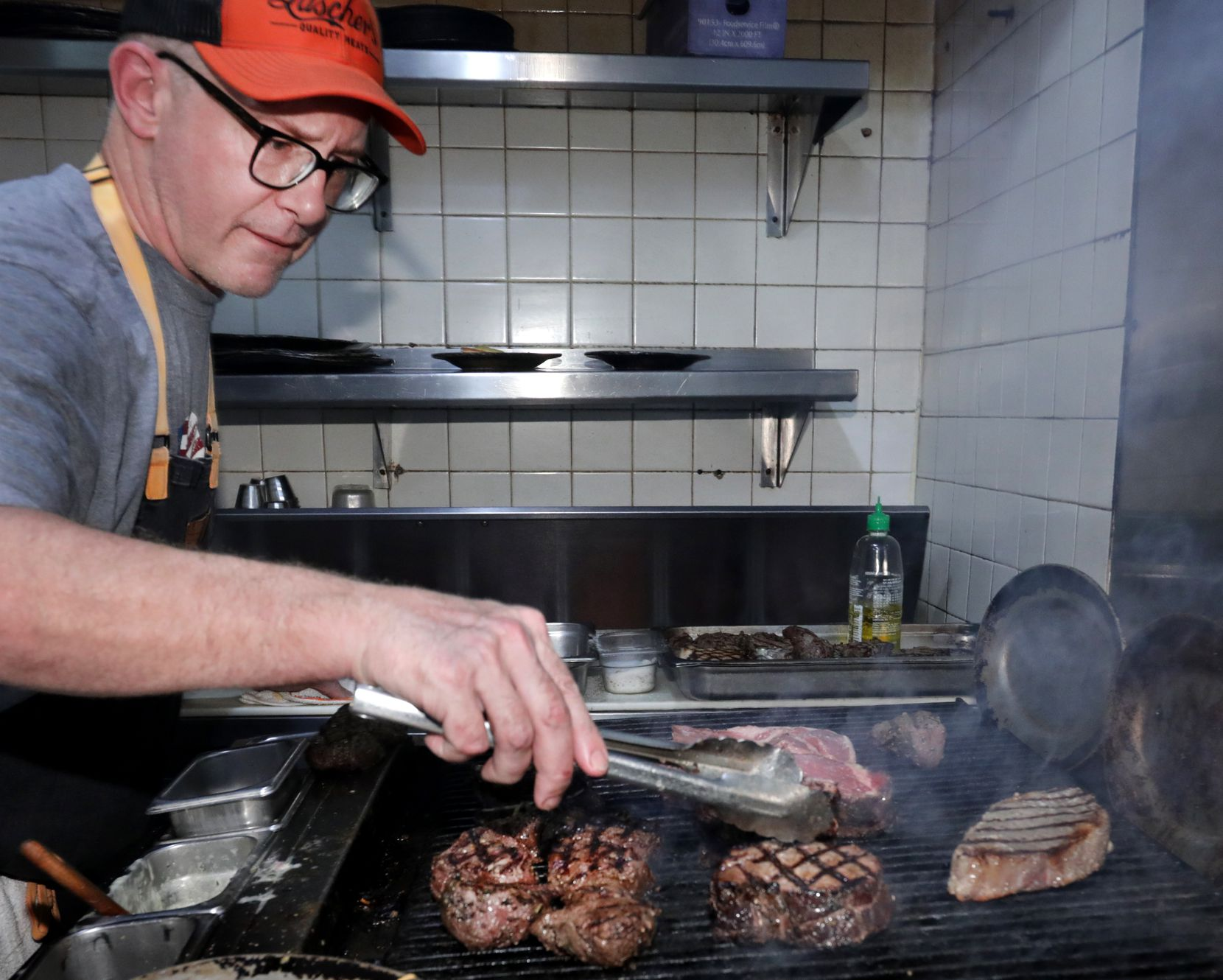 Brian Luscher, the second owner and chef, works the grill.