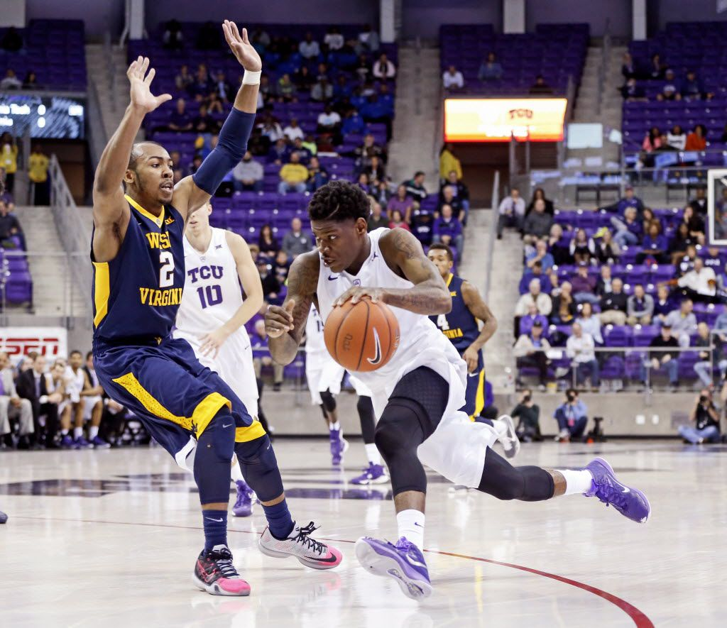 Jan 4, 2016; Fort Worth, TX, USA; TCU Horned Frogs guard Chauncey Collins (1) drives to the basket as West Virginia Mountaineers guard Jevon Carter (2) defends during the first half at Ed and Rae Schollmaier Arena.