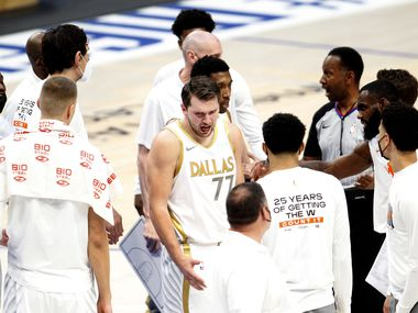 Dallas Mavericks point guard Luka Doncic (77) is angered by a call and turns away from a discussion with a game official during a first quarter timeout in their game against the Toronto Raptors. The two teams played their NBA game at the American Airlines Center in Dallas on May 14, 2021.