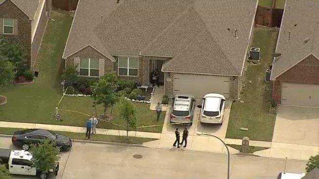 Fort Worth police at the scene of a house in the 2000 block of Speckle Drive, where four bodies were found Monday.