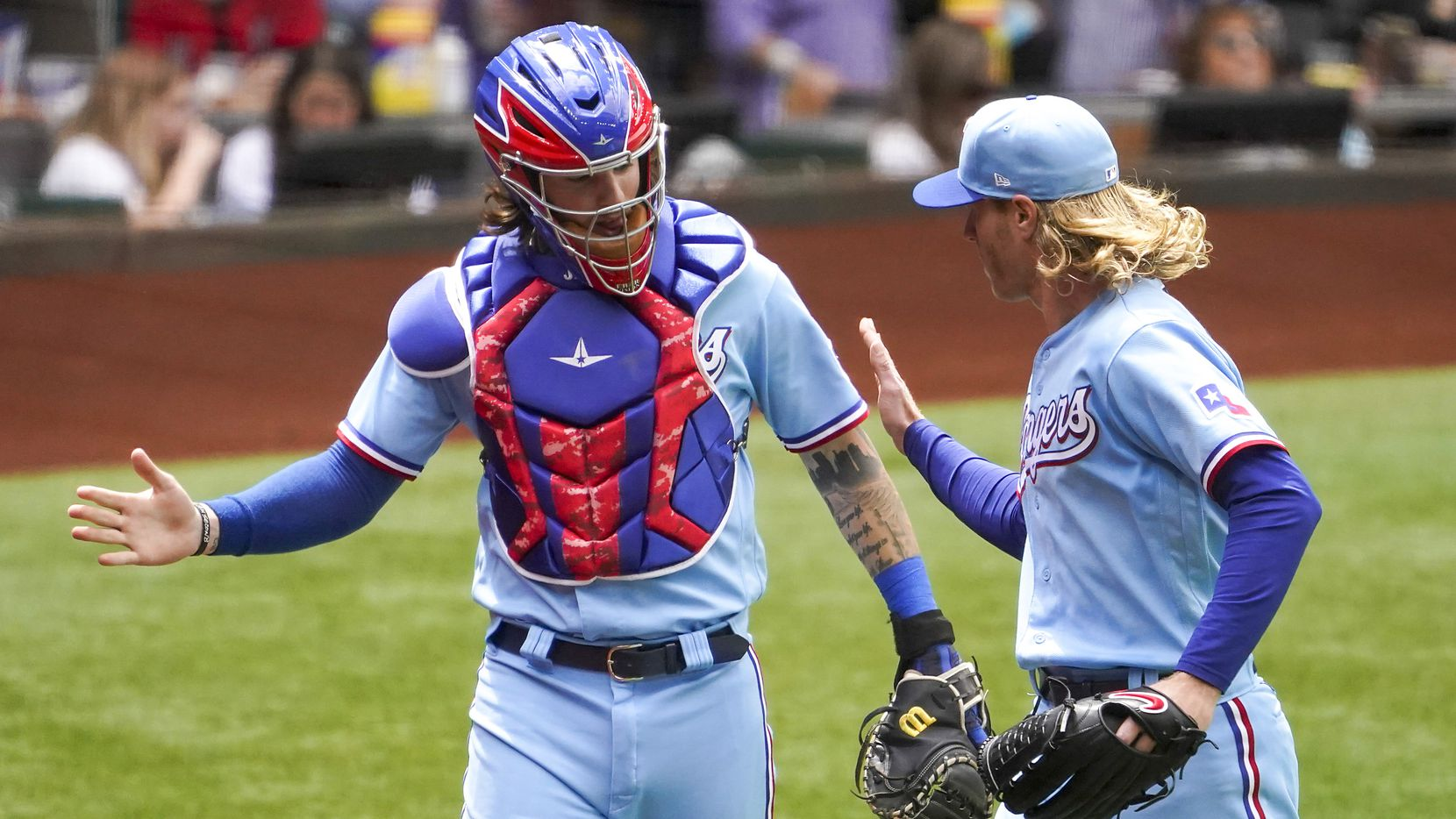 Texas Rangers starting pitcher Mike Foltynewicz celebrates with catcher Jonah Heim after gettting a double play to end the fifth inning against the Boston Red Soxat Globe Life Field on Sunday, May 2, 2021.