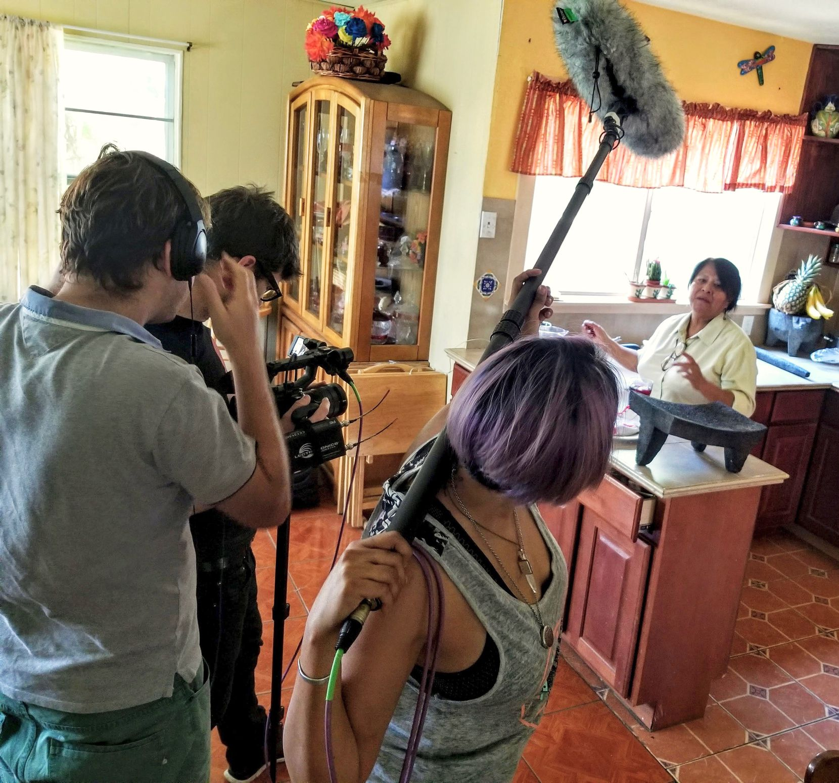 "Chef and caterer Rosalia Vargas cooks in her San Antonio home with the cameras rolling for ""Truly Texas Mexican."" The crew includes (from left) director Anibal Capoano, cinematographer Gabriel Bendahan and key grip Erica Buitron."