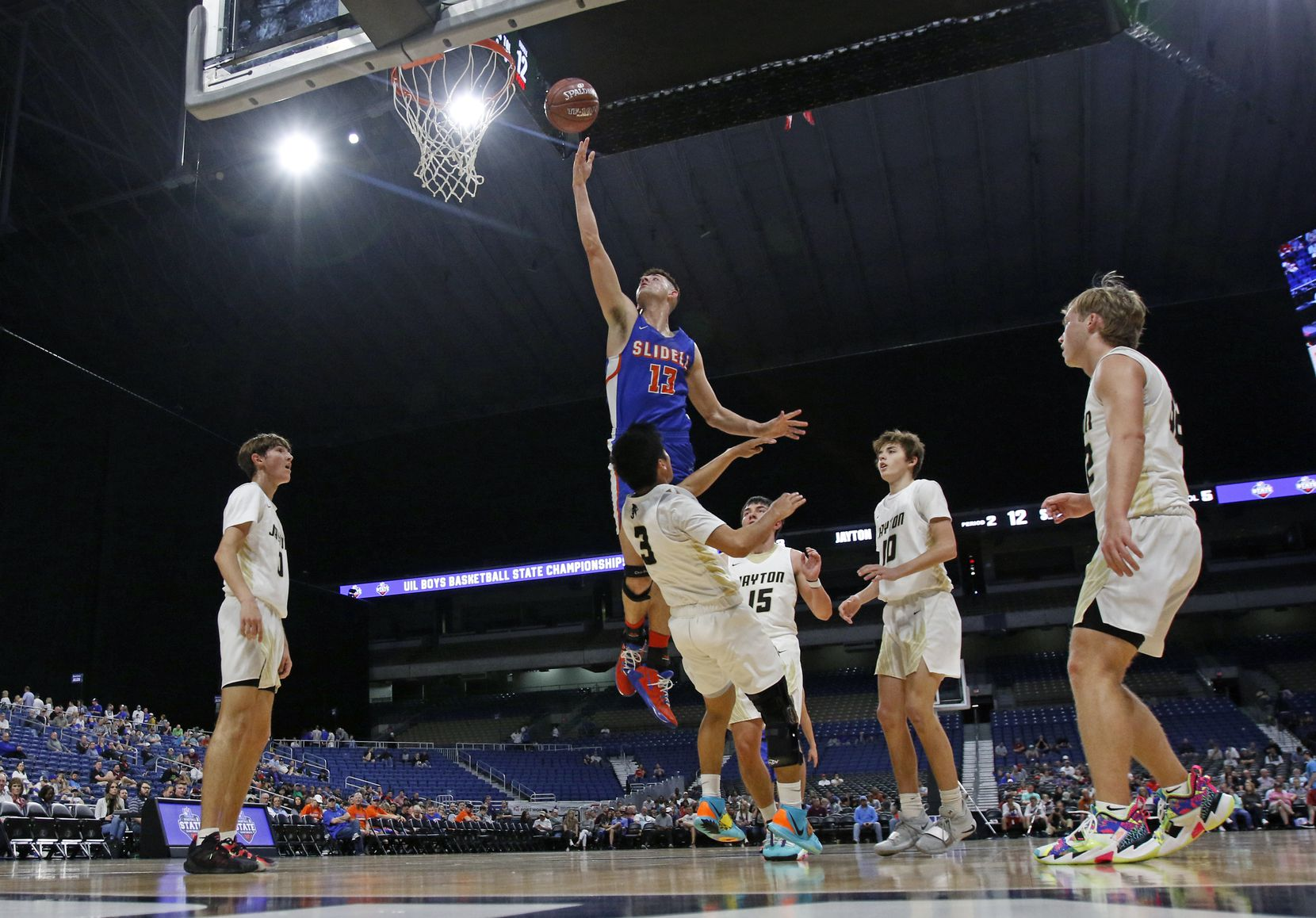 Slidell center Slayton Pruett #13 drives for two over Jayton guard Aaron Hernandez #3. Slidell defeated Jayton 45-28 in a Class 1A semifinal game on Thursday, March 12, 2020 at the Alamodome.