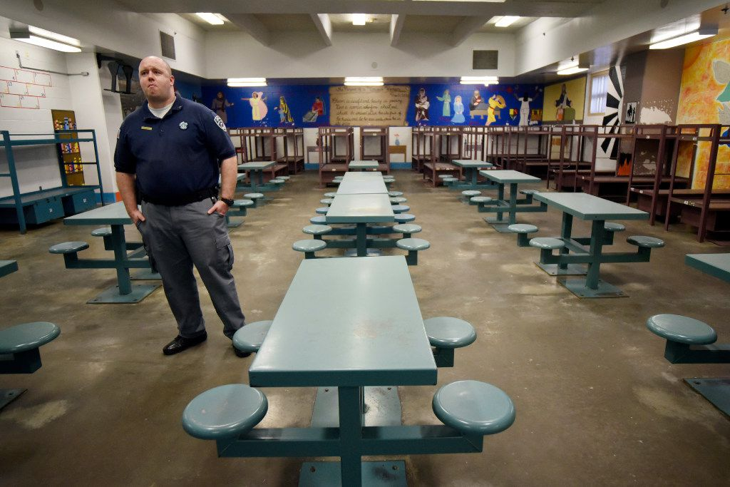 Correctional officer Max Faurot stands near dining tables inside a woman's hall during a tour of the Jesse R. Dawson State Jail on March 06, 2017.