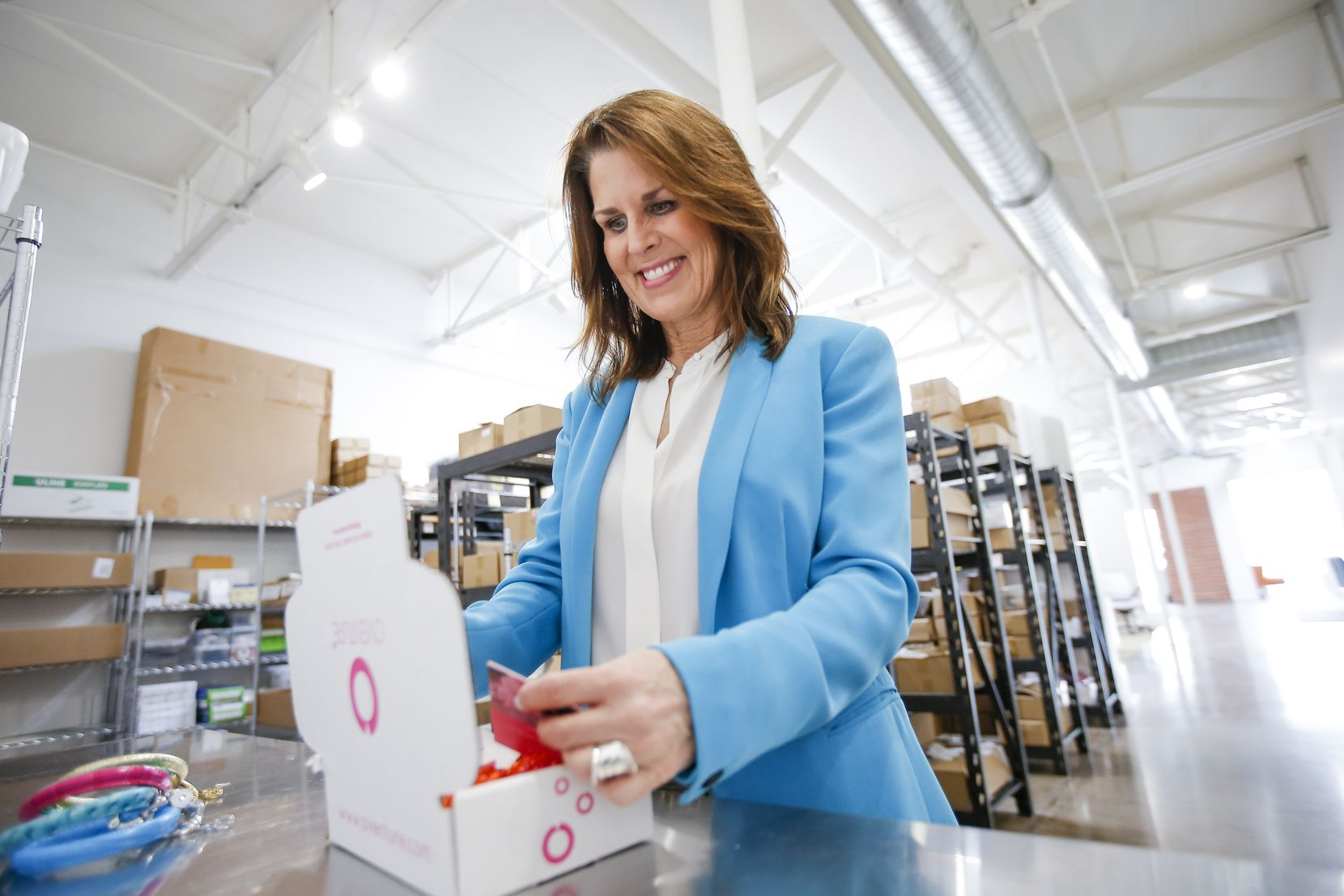 """Jana Wood, Oventure's customer experience manager, packs a small """"influencer mailing"""" box at the company's office."""