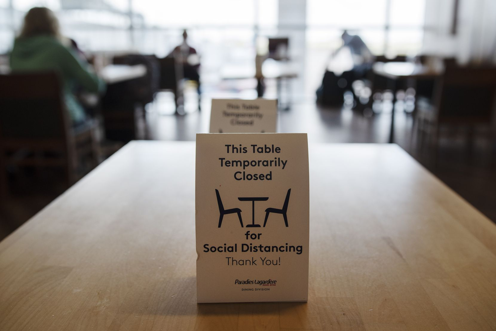 Social distancing signage at the Hickory restaurant inside Terminal B at DFW International Airport last Thursday.
