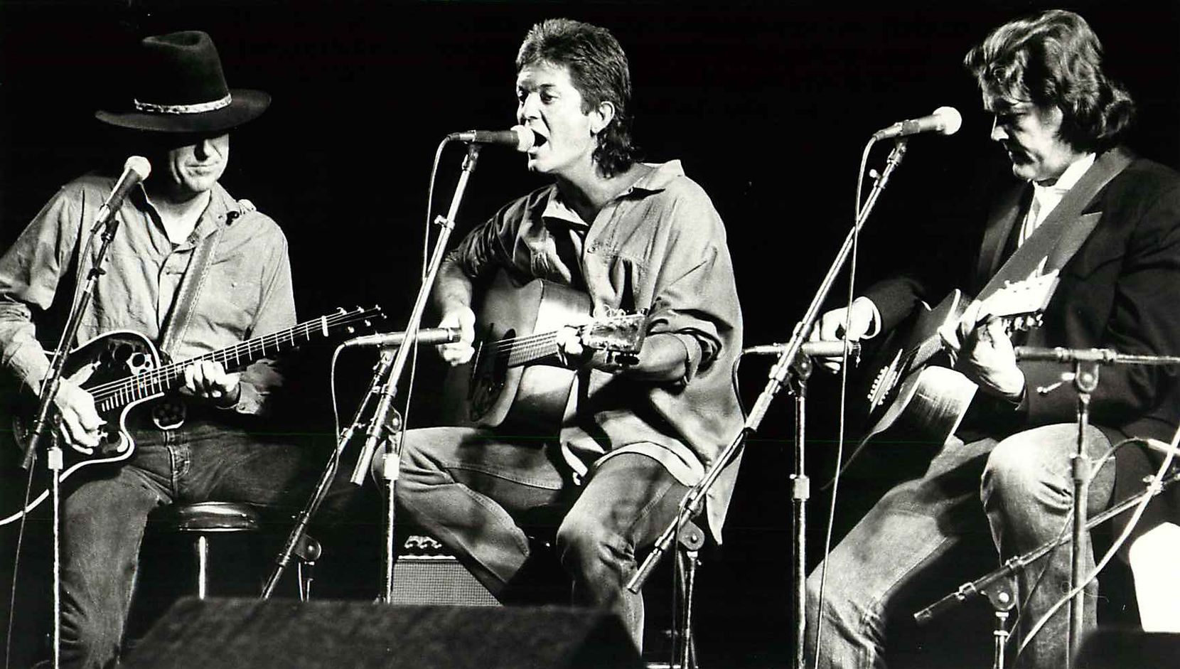 From left, Jerry Jeff Walker, Rodney Crowell and Guy Clark perform at the Arcadia Theater in Dallas on April 5, 1985.