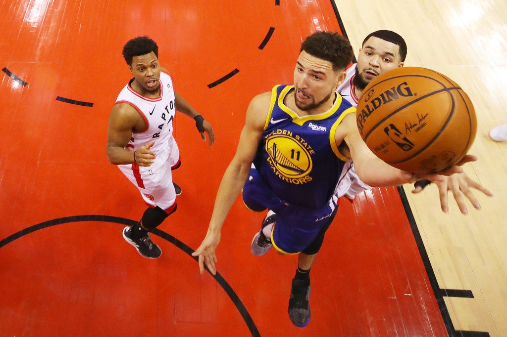 TORONTO, ONTARIO - JUNE 02:  Klay Thompson #11 of the Golden State Warriors attempts a shot against Fred VanVleet #23 of the Toronto Raptors during Game Two of the 2019 NBA Finals at Scotiabank Arena on June 02, 2019 in Toronto, Canada.  NOTE TO USER: User expressly acknowledges and agrees that, by downloading and or using this photograph, User is consenting to the terms and conditions of the Getty Images License Agreement. (Photo by Kyle Terada - Pool/Getty Images)