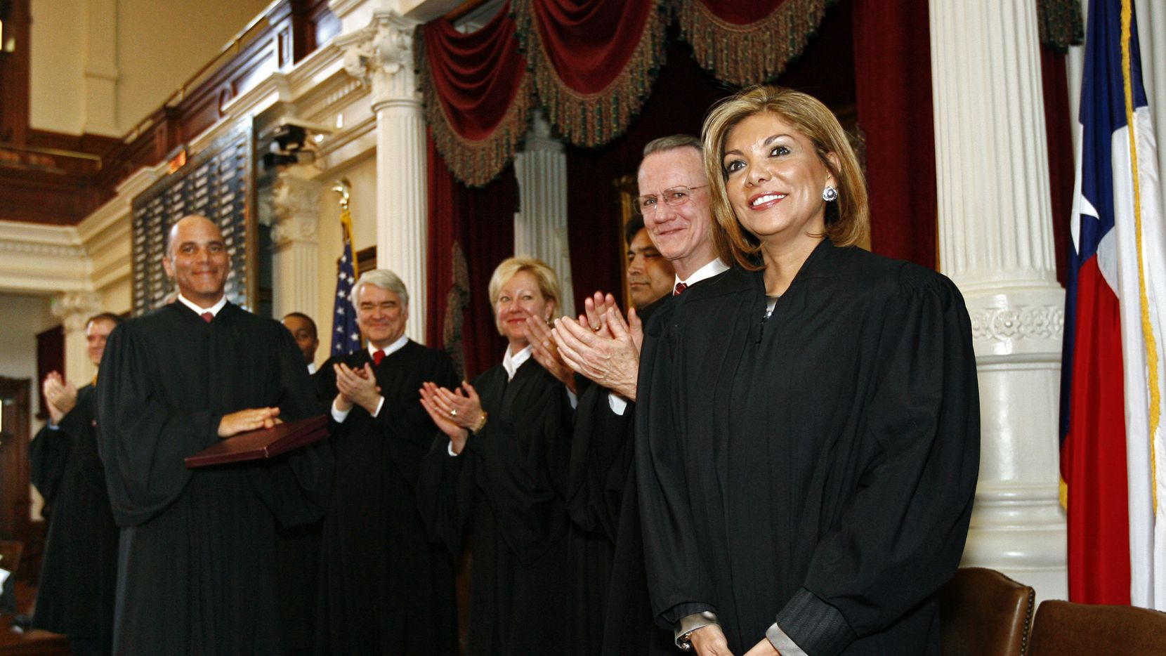 ORG XMIT: TXES103 Justice Eva A. Guzman is congratulated by fellow justices after being  sworn into the Texas Supreme Court by Texas Gov. Rick Perry at the Texas State Capitol in Austin, Texas, Monday, Jan. 11, 2010. (AP Photo/Erich Schlegel)