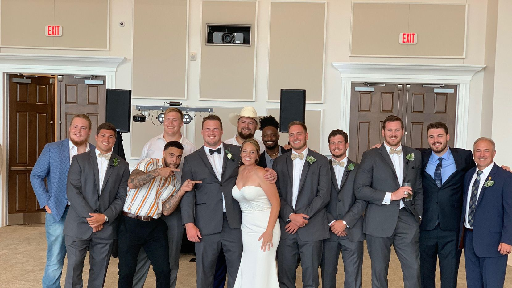 Baylor football player Sam Tecklenburg and wife Kelsey Stevens are surrounded by their wedding party at The Bowden in Keller on July 5, 2020. At far right is Baylor associate head coach/outside linebackers coach Joey McGuire, who officiated the wedding.