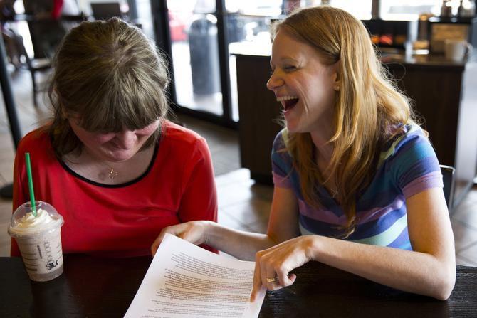 Bosnian war refugee Belma Islamovic (left) and Nicole Stewart, who started DMA Late Night's storytelling series Oral Fixation, edit Islamovic's story.