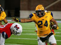 McKinney's RJ Carver (24) breaks past McKinney Boyd's Caden Park (17) during the second half of a high school football matchup between McKinney and McKinney Boyd at McKinney ISD Stadium on Friday, Nov. 8, 2019 in McKinney, Texas.