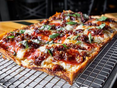 The owners of Cane Rosso are starting a new pizza shop called Thunderbird Pies, which sells Detroit-style pizza beginning Aug. 10, 2020. They're taking the ingredients from Cane Rosso's popular Honey Bastard pie — hot soppressata, bacon marmalade and habanero honey — and putting them on a crunchier, cheesier pizza.