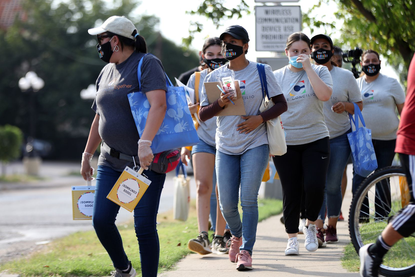 Volunteer moms with the Community Action Network walked door to door Aug. 5 inviting residents in the Bachman Lake area to fill out the 2020 Census.