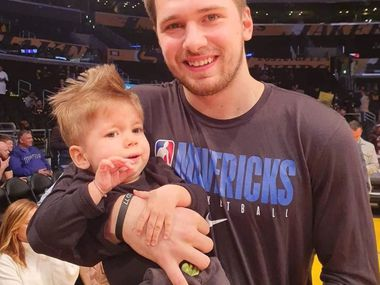 Luka Doncic holds Kris Zudich, the 22-month-old Slovenian boy with a rare genetic disease called 1 spinal muscular atrophy, ahead of the Mavericks game against the Lakers on Sunday, Dec. 1, 2019 in Los Angeles.