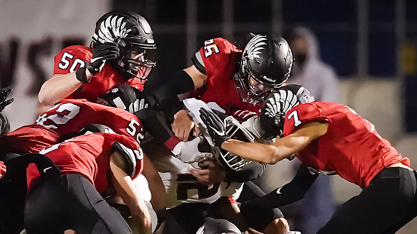 Melissa running back Ashton Mitchell-Johnson (12) is brought down by the Argyle defense during the first half of a high school football game on Friday, Oct. 2, 2020, in Argyle, Texas.