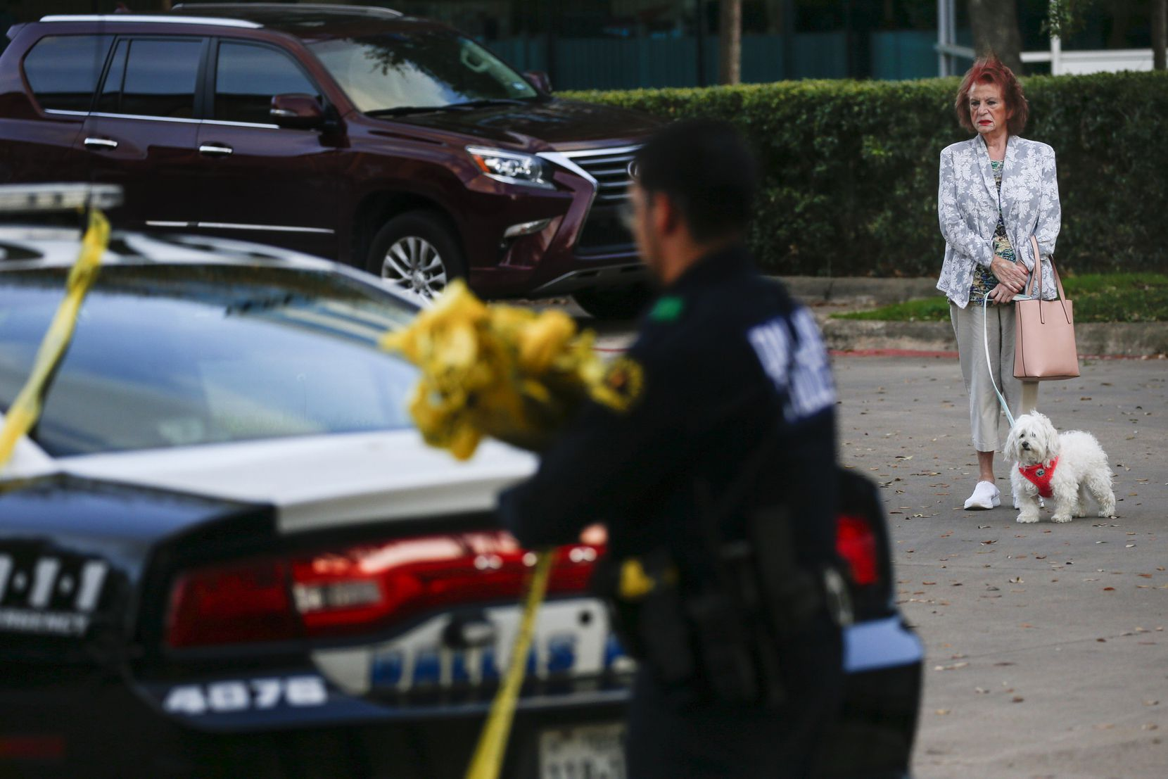 A bystander watches as Dallas police wrap up at a crime scene where two children and two adults were found shot to death at a Staybridge Suites near Keller Springs Road and the Dallas North Tollway on Tuesday, March 10, 2020 in Dallas. (Ryan Michalesko/The Dallas Morning News)