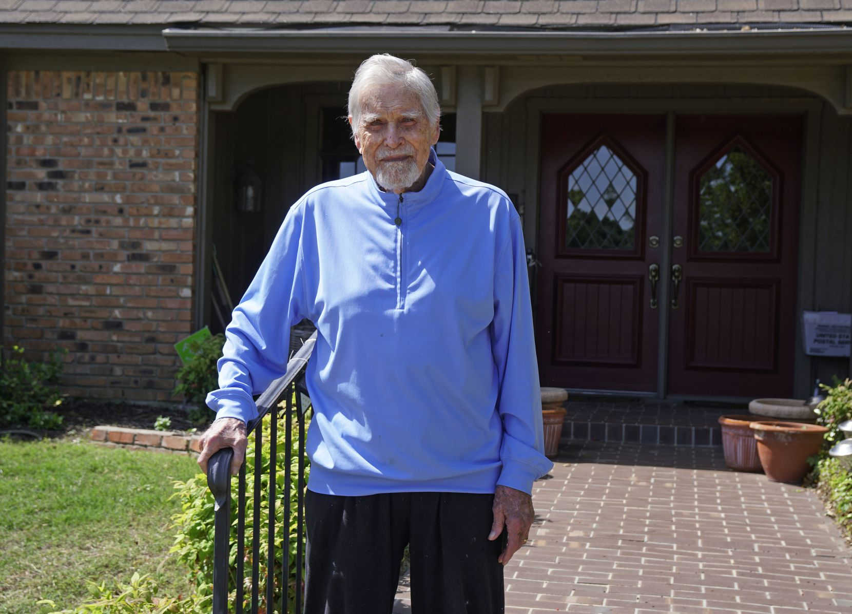 Eddie Robinson stands on the front steps of his home in Fort Worth. He is the oldest living former Major League Baseball player.