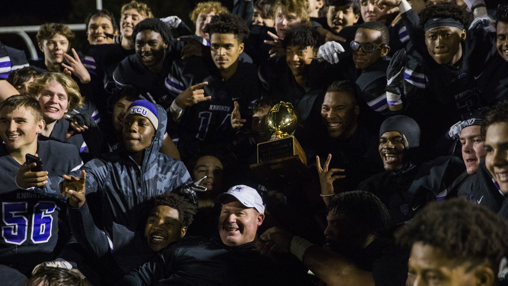 Frisco Independence football players pose for a photo with the bi-district championship trophy after a UIL Class 5A Division I first-round playoff football game between Mansfield Timberview and Frisco Independence on Thursday, November 14, 2019 at Frisco ISD Memorial Stadium in Frisco. Frisco Independence won 43-28.