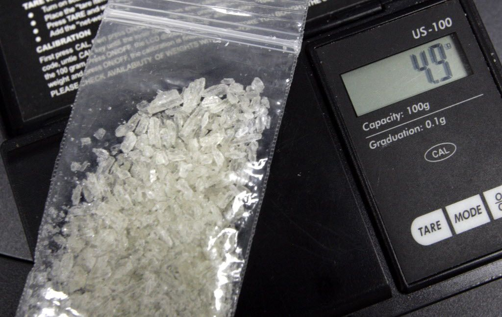 """ORG XMIT: *S0412044356* Don Yarbrough, a member of the Henderson County  Drug Enforcement Unit weighs some """"Ice"""", a clear crystal-type methamphetamine on March 2, 2005."""