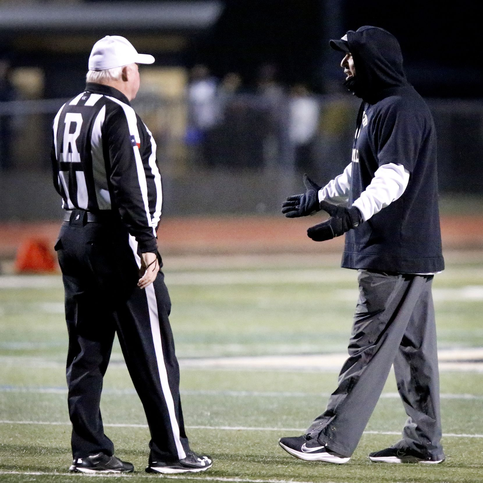 The Colony High School head coach Rudy Rangel questions a call which cancelled a touchdown during the first half as The Colony High School hosted Frisco Reedy High School at Tommy Briggs Stadium on Friday night, December 4, 2020.  (Stewart F. House/Special Contributor)