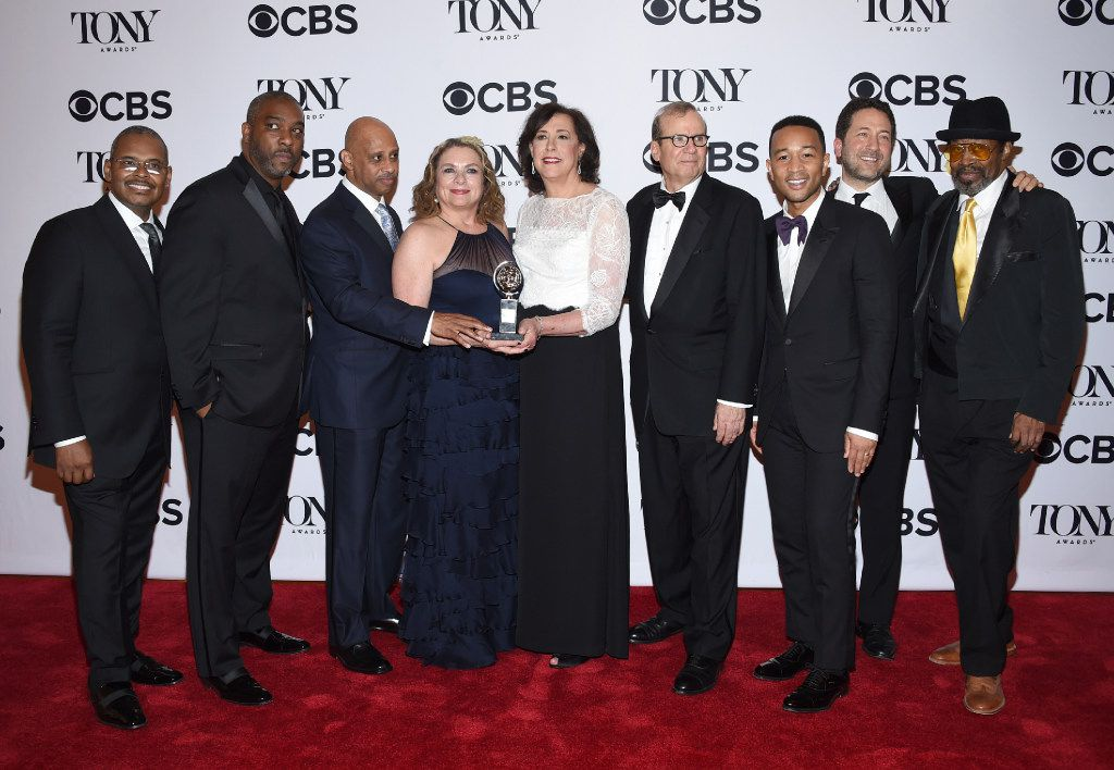 """The cast and crew of """"August Wilson's Jitney"""" pose in the press room with the award for best revival of a play at the 71st annual Tony Awards on Sunday, June 11, 2017, in New York. (Photo by Evan Agostini/Invision/AP)"""