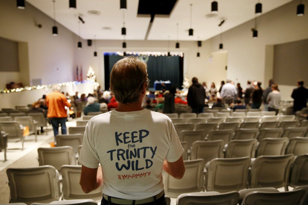 Mark Spence stands in the back of the auditorium moments before the beginning of a town hall meeting and debate about the Trinity Parkway toll road moderated by State Representative Rafael Anchia at Rosemont Primary School in Dallas Wednesday December 3, 2014. (Andy Jacobsohn/The Dallas Morning News)