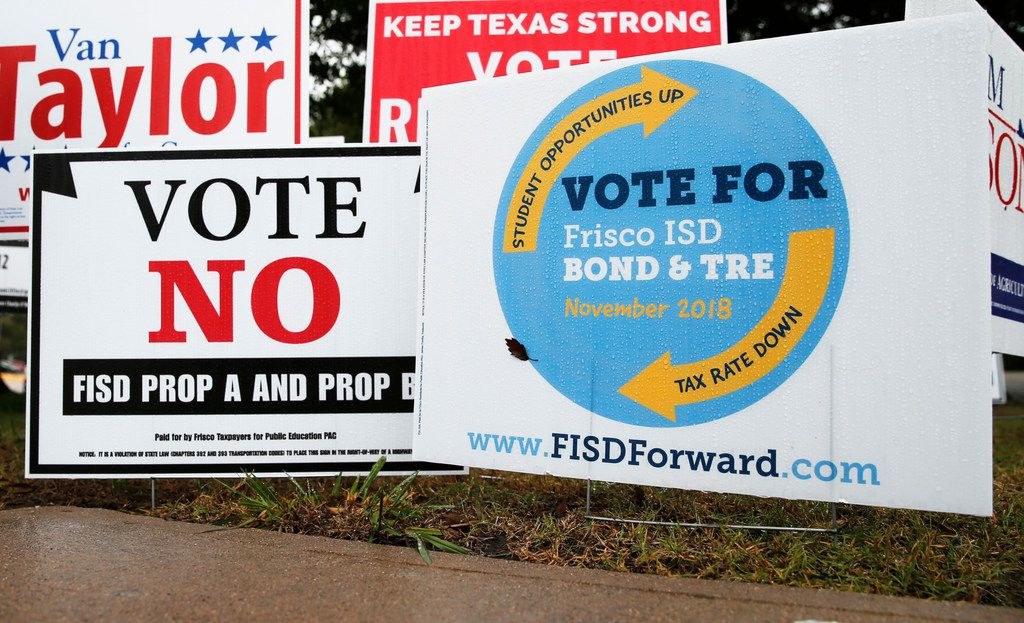 Signs for and against the Frisco ISD bond and tax ratification election outside a polling station at Collin College Preston Ridge Campus in Frisco on Thursday, Oct. 25, 2018.