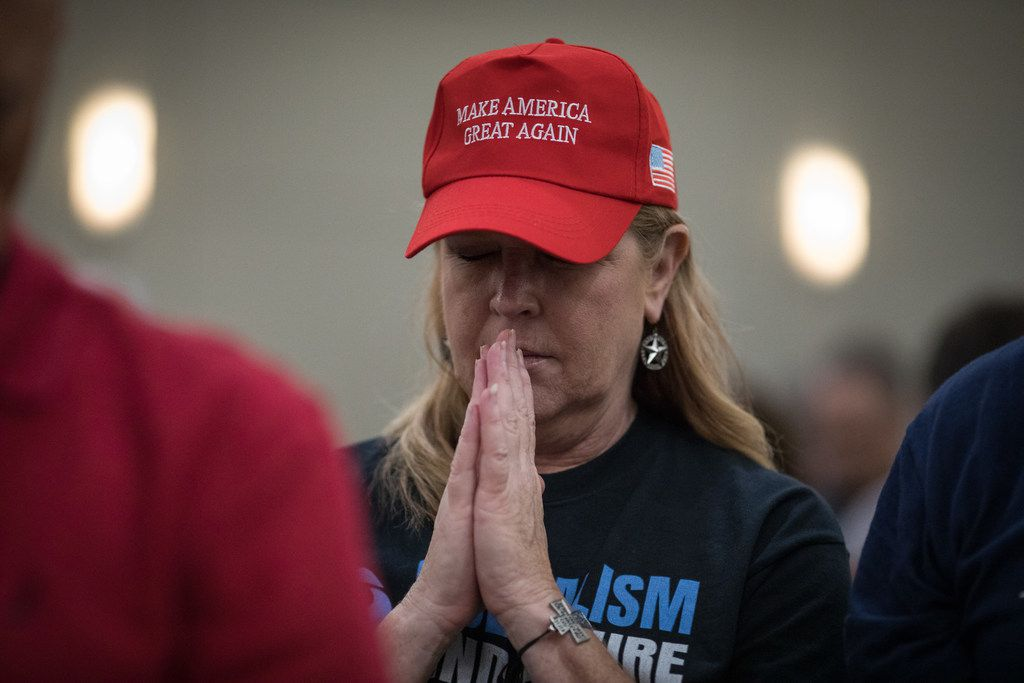 Trump supporter Sharon Alford participates in a group prayer at the start of a campaign rally for Sen. Ted Cruz on October 3, 2018 in Conroe.