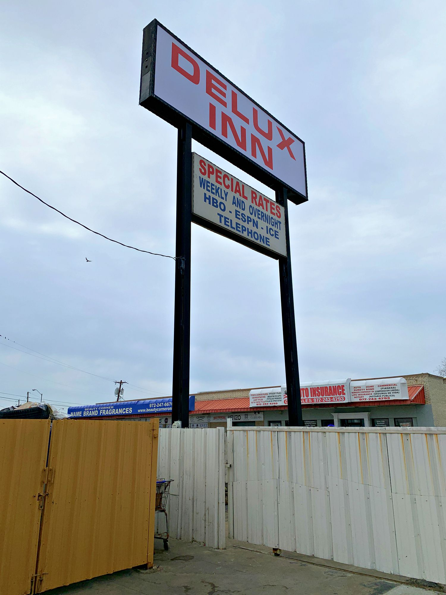 The motel's sign, amid the businesses of the Asian Trade District at Royal Lane and Harry Hines Boulevard in northwest Dallas